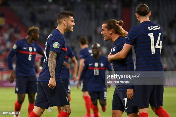 Lucas Hernandez, Antoine Griezmann and Adrien Rabiot of France celebrate their side's first goal, an own goal by Mats Hummels of Germany during the...