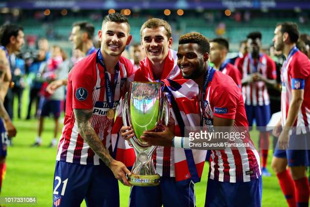 Lucas Hernandez Antoine Griezmann and Thomas Lemar of Atletico Madrid celebrate with the trophy after winning the UEFA Super Cup between Real Madrid...