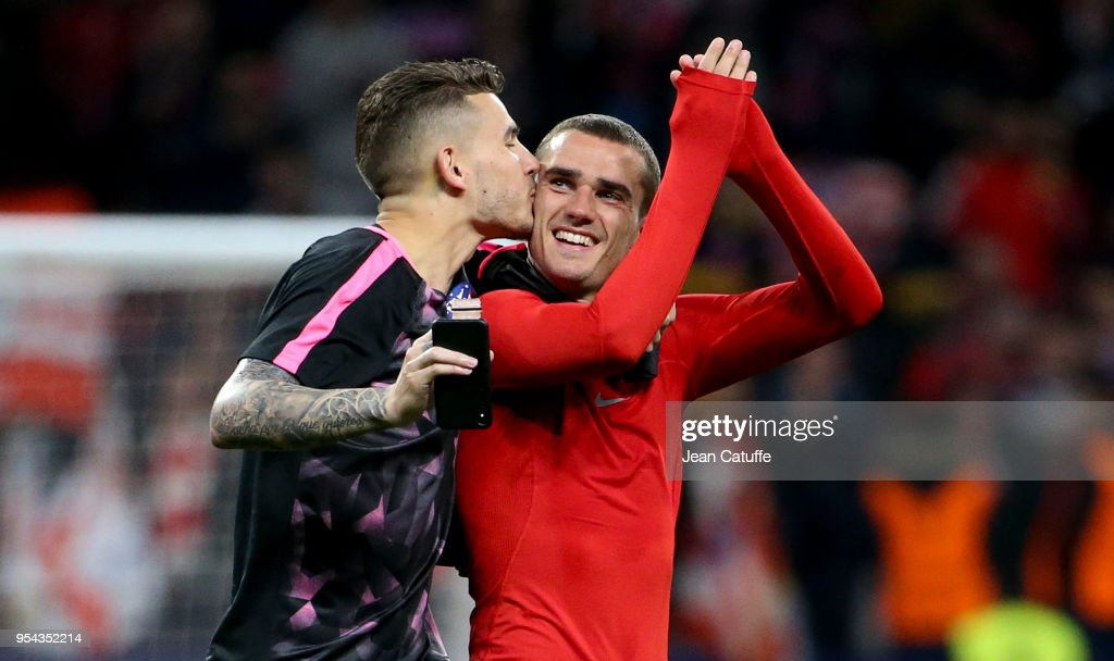 Lucas Hernandez kisses Antoine Griezmann of Atletico Madrid to celebrate the qualification for the final following the UEFA Europa League Semi Final second leg match between Atletico Madrid and Arsenal FC at Estadio Wanda Metropolitano on May 3, 2018 in Madrid, Spain.