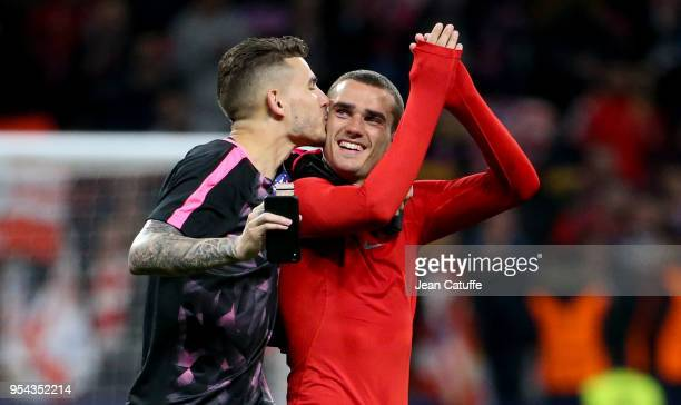 Lucas Hernandez kisses Antoine Griezmann of Atletico Madrid to celebrate the qualification for the final following the UEFA Europa League Semi Final...
