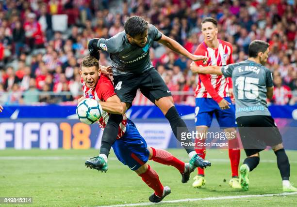 Lucas Hernandez of Atletico de Madrid battles for the ball with Luis Hernandez Rodriguez of Malaga CF during the La Liga 201718 match between...