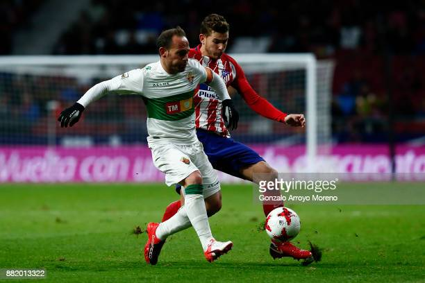 Lucas Hernandez of Atletico de Madrid competes for the ball with Juan Francisco Martinez alias Nino of Elche CF during the Copa del Rey second leg...
