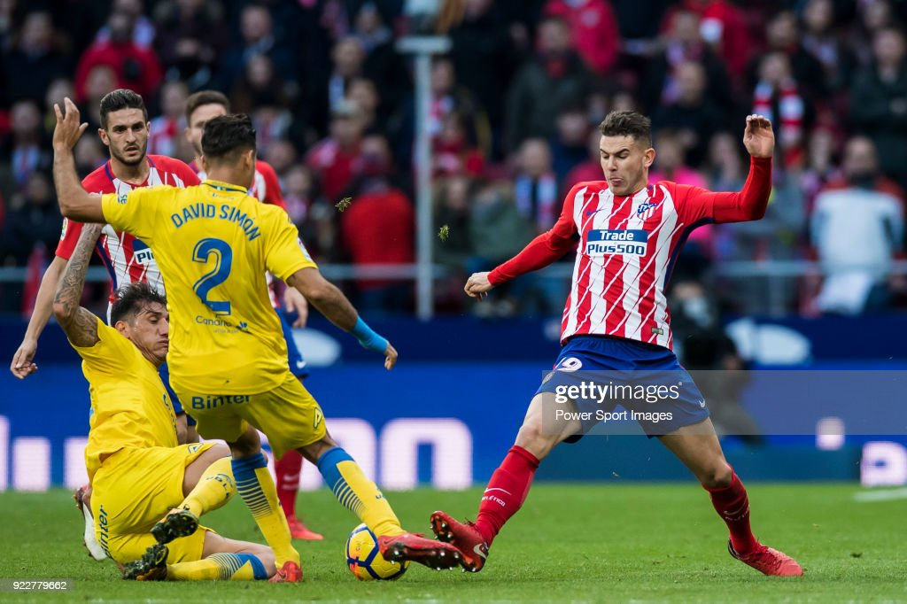 Lucas Hernandez (R) of Atletico de Madrid competes for the ball with players of UD Las Palmas during the La Liga 2017-18 match between Atletico de Madrid and UD Las Palmas at Wanda Metropolitano on January 28 2018 in Madrid, Spain.