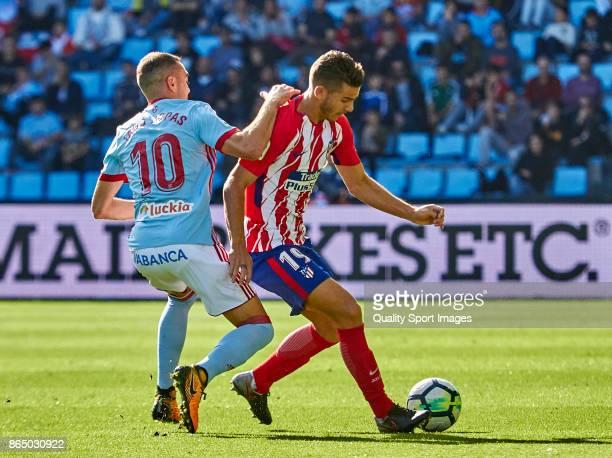 Lucas Hernandez of Atletico de Madrid is challenged by Iago Aspas of Celta de Vigo during the La Liga match between Celta de Vigo and Atletico Madrid...