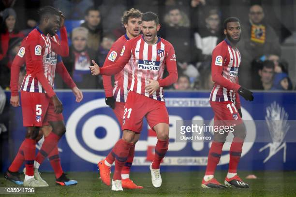 Lucas Hernandez of Atletico Madrid celebrates after scoring his sides first goal during the La Liga match between SD Huesca and Club Atletico de...