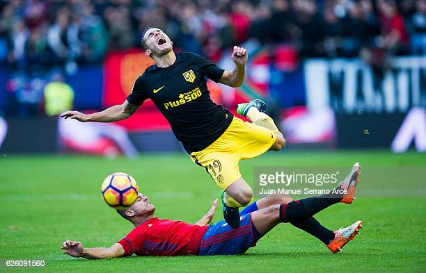 Lucas Hernandez of Atletico Madrid duels for the ball with Cayetano Bonnin 'tano' of CA Osasuna during the La Liga match between CA Osasuna and...