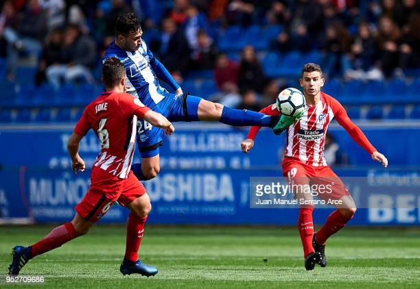 Lucas Hernandez of Atletico Madrid duels for the ball with Munir El Haddadi of Deportivo Alaves during the La Liga match between Deportivo Alaves and...