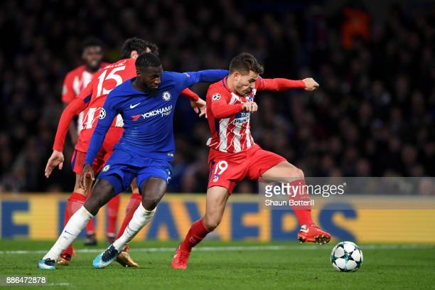 Lucas Hernandez of Atletico Madrid is challenged by Tiemoue Bakayoko of Chelsea during the UEFA Champions League group C match between Chelsea FC and...