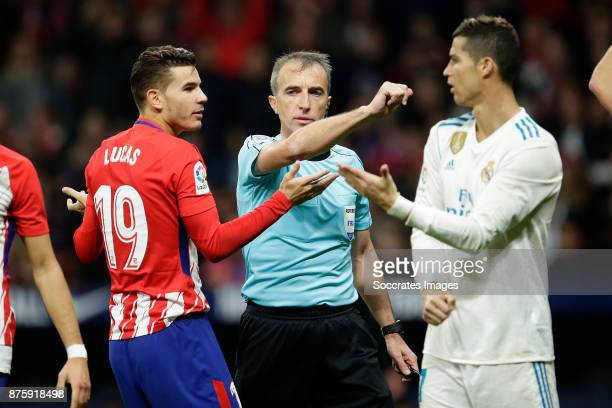 Lucas Hernandez of Atletico Madrid Referee David Fernandez Cristiano Ronaldo of Real Madrid during the Spanish Primera Division match between...