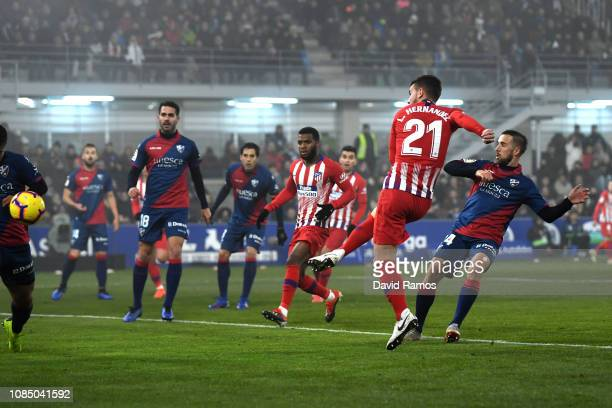 Lucas Hernandez of Atletico Madrid scores his sides first goal during the La Liga match between SD Huesca and Club Atletico de Madrid at Estadio El...