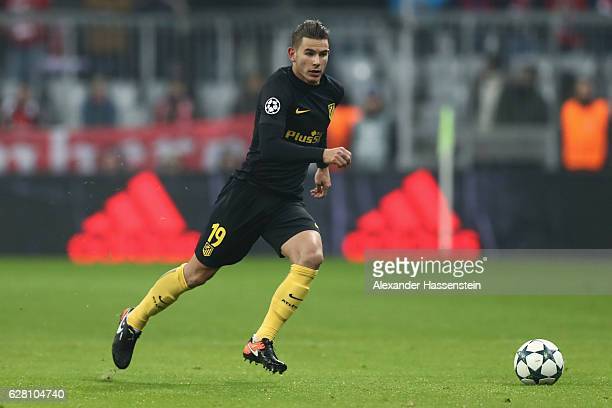Lucas Hernandez of Atletico runs with the ball during the UEFA Champions League match between FC Bayern Muenchen and Club Atletico de Madrid at...