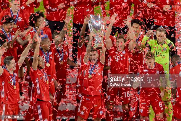 Lucas Hernandez of Bayern Muenchen cheers after winning the Supercup after the UEFA Super Cup match between FC Bayern Munich and FC Sevilla at Puskas...