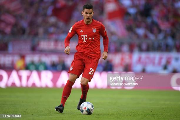 Lucas Hernandez of Bayern Munich plays the ball during the Bundesliga match between FC Bayern Muenchen and 1 FC Koeln at Allianz Arena on September...