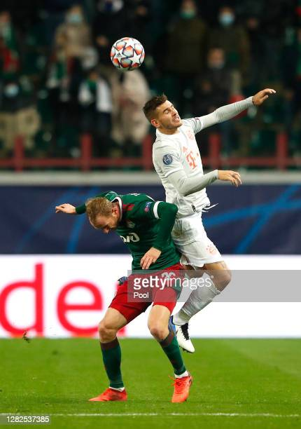 Lucas Hernandez of Bayern Munich wins a header over Vladislav Ignatyev of Lokomotiv Moscow during the UEFA Champions League Group A stage match...