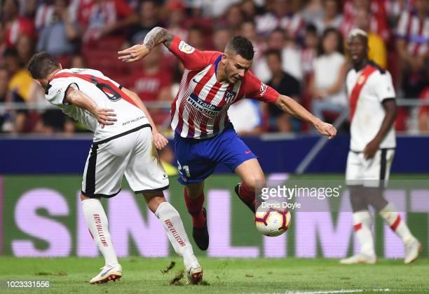 Lucas Hernandez of Club Atletico de Madrid challenges Gorka Elustondo Urkola of Rayo Vallecano de Madrid during the La Liga match between Club...