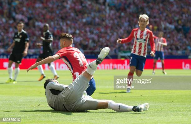 Lucas Hernandez of Club Atletico de Madrid clashes with Sergio Rico of Sevilla FC during the La Liga match between Atletico Madrid and Sevilla at...