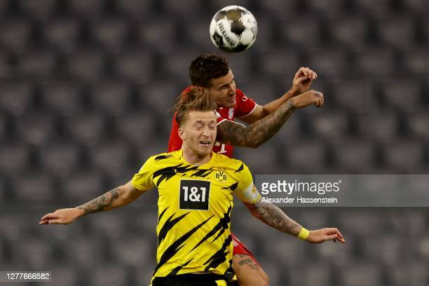 Lucas Hernandez of FC Bayern Muenchen battles for the ball with Marco Reus of Dortmund the ball during the Supercup 2020 match between FC Bayern...