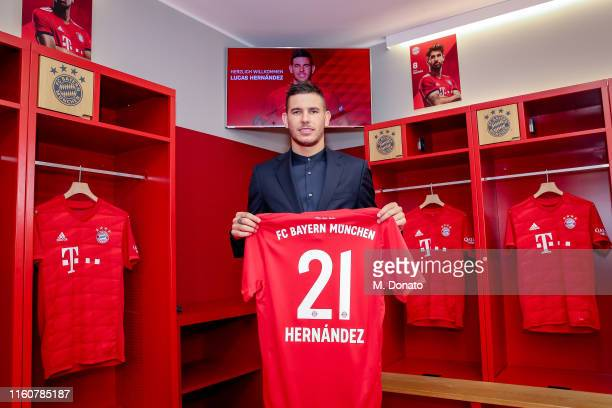 Lucas Hernandez of FC Bayern Muenchen poses with his jersey after a press conference to announce new signing Lucas Hernandez at Allianz Arena on July...