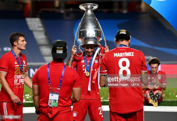 Lucas Hernandez of FC Bayern Munich celebrates with the UEFA Champions League Trophy following his team's victory in the UEFA Champions League Final...