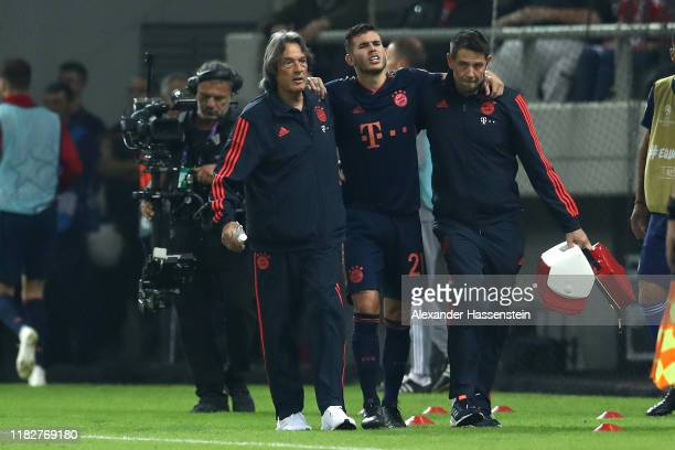 Lucas Hernandez of FC Bayern Munich receives medical treatment during the UEFA Champions League group B match between Olympiacos FC and Bayern...