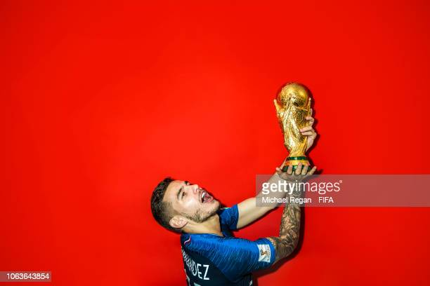 Lucas Hernandez of France poses with the Champions World Cup trophy after the 2018 FIFA World Cup Russia Final between France and Croatia at Luzhniki...