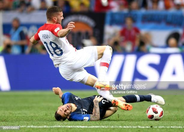 Lucas Hernandez of France tackles Ante Rebic of Croatia during the 2018 FIFA World Cup Final between France and Croatia at Luzhniki Stadium on July...