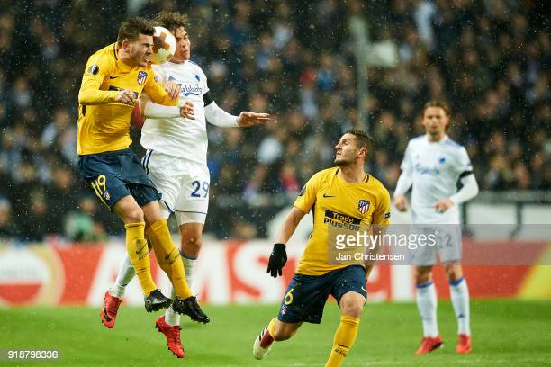 Lucas Hernández of Atlético Madrid and Robert Skov of FC Copenhagen heading the ball during the UEFA Europa League match between FC Copenhagen and...