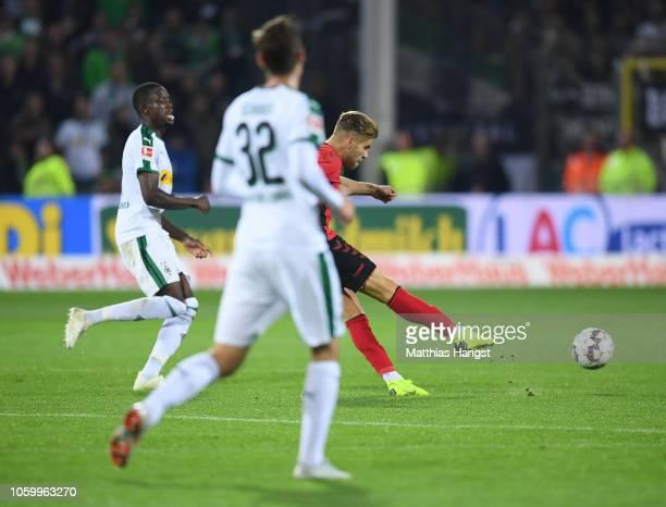 Lucas Hoefler of Freiburg scores his team's third goal during the Bundesliga match between SportClub Freiburg and Borussia Moenchengladbach at...