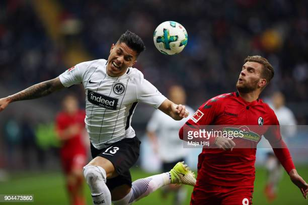 Lucas Hoeler of Freiburg fights for the ball with Carlos Salcedo of Frankfurt during the Bundesliga match between Eintracht Frankfurt and SportClub...