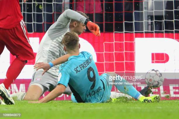 Lucas Hoeler of Freiburg scores the first team goal against Manuel Neuer keeper of Bayern Muenchen during the Bundesliga match between FC Bayern...