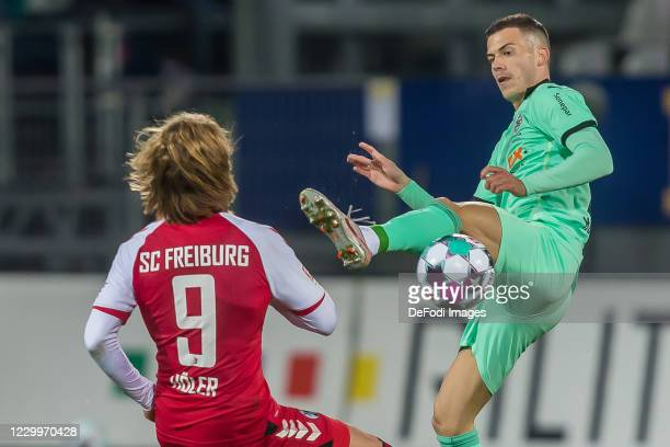 Lucas Hoeler of SC Freiburg and Laszlo Benes of Borussia Moenchengladbach battle for the ball during the Bundesliga match between Sport-Club Freiburg...