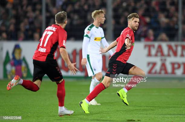 Lucas Holer of SC Freiburg celebrates scoring his side's third goal during the Bundesliga match between SportClub Freiburg and Borussia...