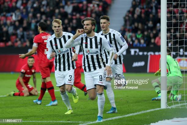 Lucas Holer of Sport-Club Freiburg celebrates after scoring his team's first goal during the Bundesliga match between Bayer 04 Leverkusen and...