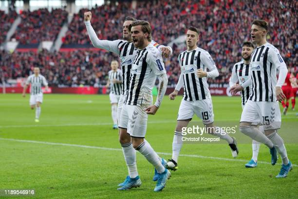 Lucas Holer of Sport-Club Freiburg celebrates after scoring his team's first goal with Christian Gunter during the Bundesliga match between Bayer 04...