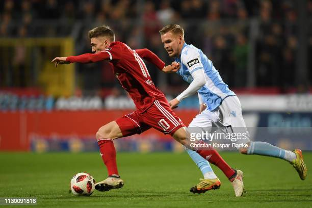 Lucas Hufnagel of SpVgg Unterhaching challenges Daniel Wein of TSV 1860 Muenchen during the 3 Liga match between TSV 1860 Muenchen and SpVgg...