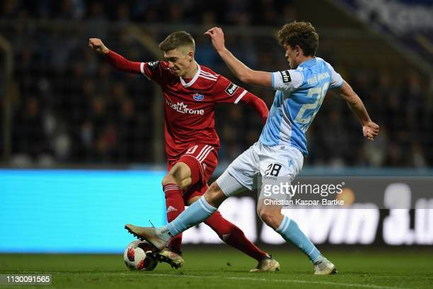 Lucas Hufnagel of SpVgg Unterhaching challenges Herbert Paul of TSV 1860 Muenchen during the 3 Liga match between TSV 1860 Muenchen and SpVgg...