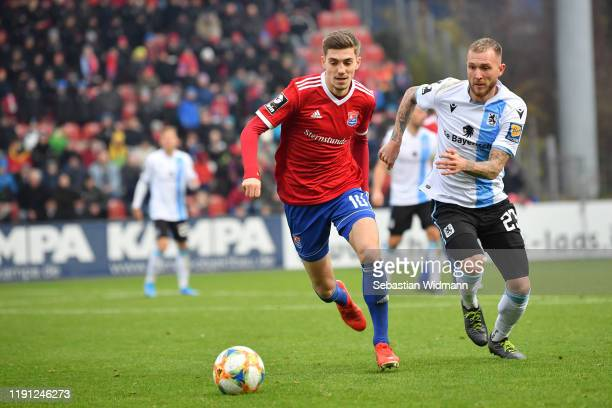 Lucas Hufnagel of Unterhaching and Tim Rieder of TSV 1860 Muenchen compete for the ball during the 3. Liga match between SpVgg Unterhaching and TSV...