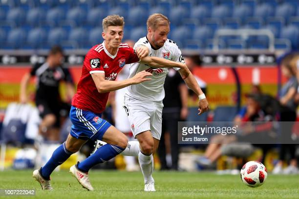 Lucas Hufnagel of Unterhaching challenges Maximilian Beister of Uerdingen during the 3 Liga match between KFC Uerdingen 05 and SpVgg Unterhaching at...
