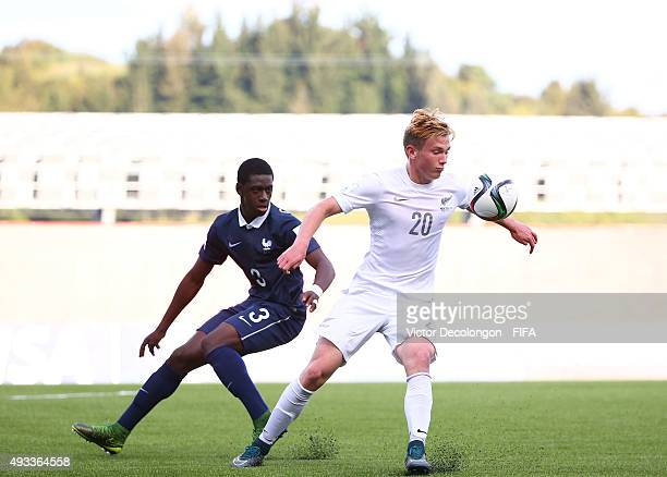 Lucas Imrie of New Zealand plays the ball under pressure from Mamadou Doucoure of France during the New Zealand v France Group F FIFA 2015 U17 World...