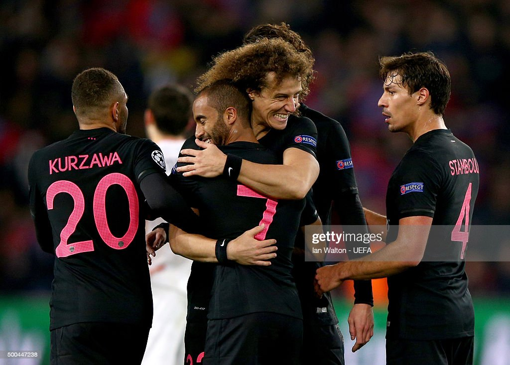 Lucas is congratulated by his teammate David Luiz after scoring the opening goal for PSG during the UEFA Champions League Group A match between Paris Saint-Germain and FC Shakhtar Donetsk at Parc des Princes on December 8, 2015 in Paris, France.