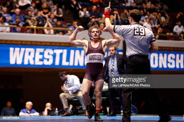 Lucas Jeske of Augsburg celebrates after defeating Nick Velez in the 165 weight class during the Division III Men's Wrestling Championship held at...