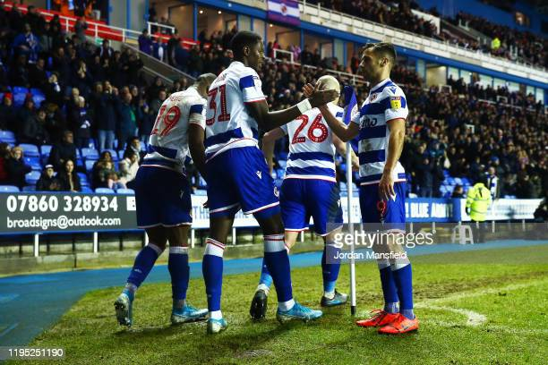 Lucas Joao of Reading celebrates with his teammates after scoring his sides second goal during the Sky Bet Championship match between Reading and...