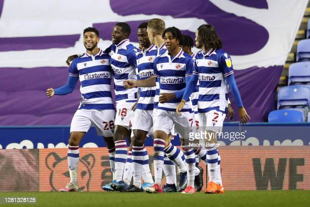 Lucas Joao of Reading celebrates with teammates after scoring his sides first goal during the Sky Bet Championship match between Reading and Wycombe...