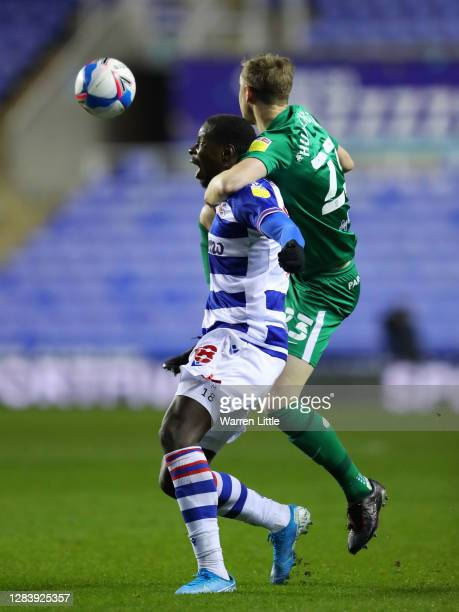 Lucas Joao of Reading is challenged by Paul Huntington of Preston North End during the Sky Bet Championship match between Reading and Preston North...