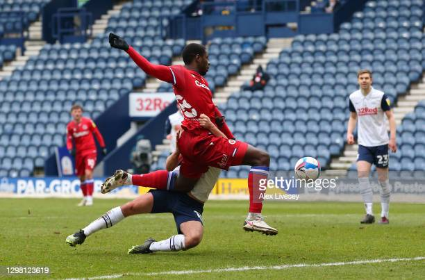 Lucas Joao of Reading is fouled by Joe Rafferty of Preston North End, resulting in a penalty during the Sky Bet Championship match between Preston...