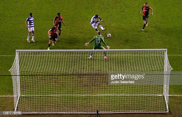 Lucas Joao of Reading scores their sides first goal past Ben Wilson of Coventry City during the Sky Bet Championship match between Reading and...