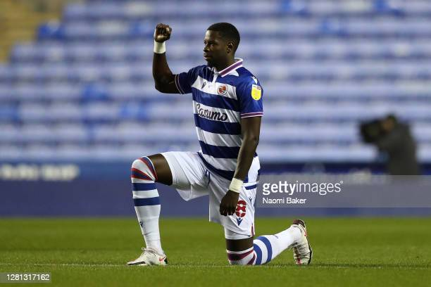 Lucas Joao of Reading takes a knee in support of the Black Lives Matter movement prior to the Sky Bet Championship match between Reading and Wycombe...