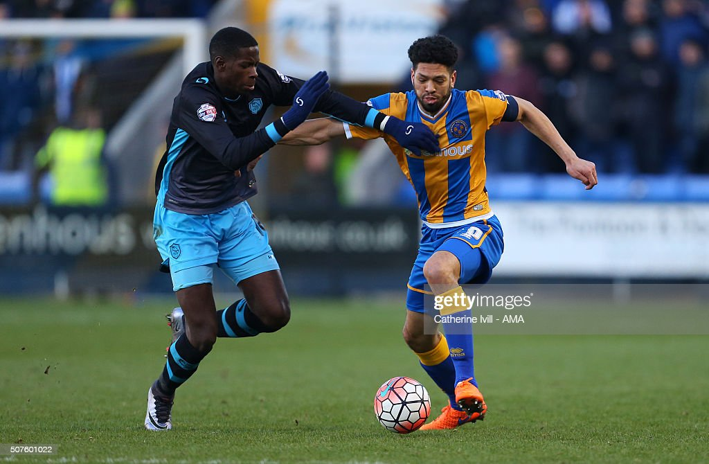 Lucas Joao of Sheffield Wednesday and Nathaniel Knight-Percival of Shrewsbury Town during the Emirates FA Cup match between Shrewsbury Town and Sheffield Wednesday at New Meadow on January 30, 2016 in Shrewsbury, England.