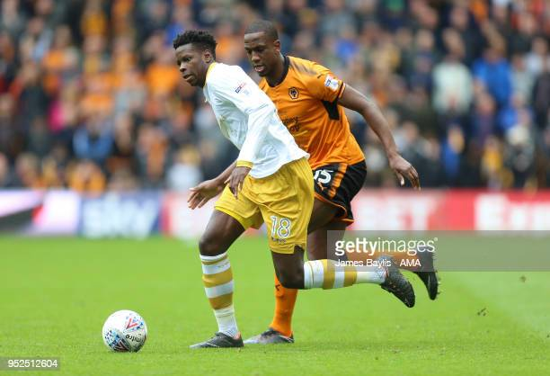 Lucas Joao of Sheffield Wednesday and Willy Boly of Wolverhampton Wanderers during the Sky Bet Championship match between Wolverhampton Wanderers and...