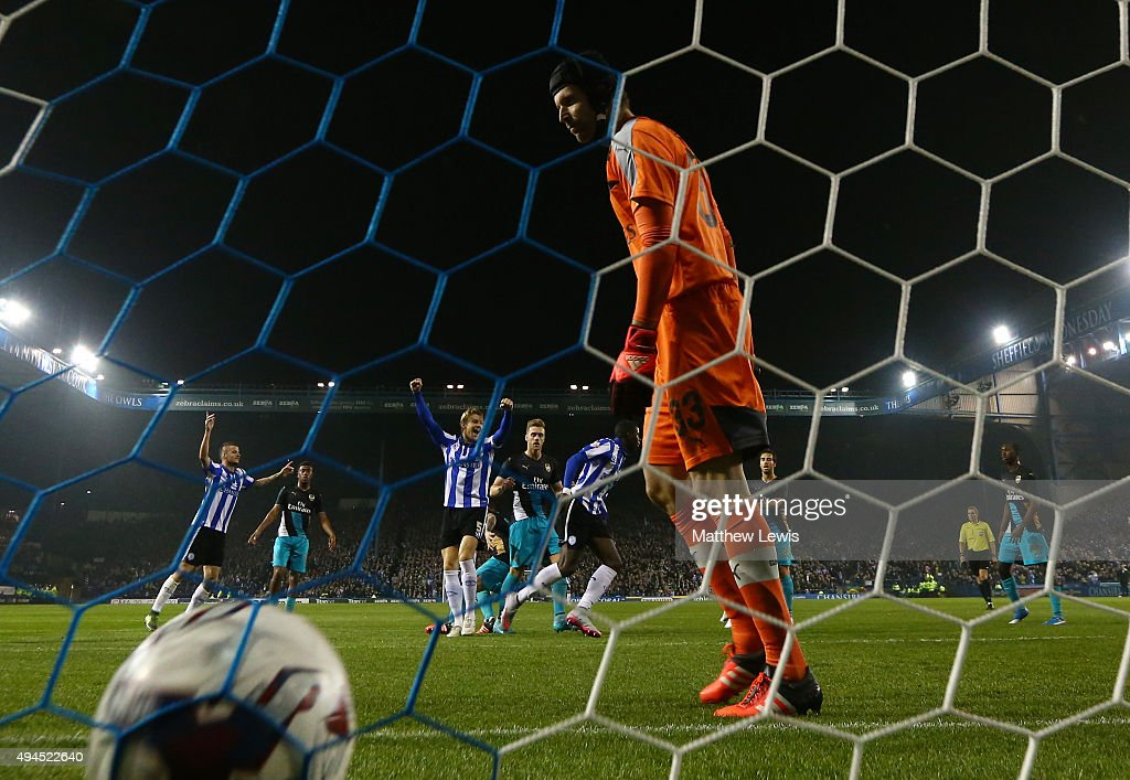 Lucas Joao (C) of Sheffield Wednesday celebrates after scoring his team's second goal as the dejected Petr Cech of Arsenal looks on during the Capital One Cup fourth round match between Sheffield Wednesday and Arsenal at Hillsborough Stadium on October 27, 2015 in Sheffield, England.